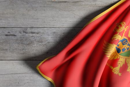 balkan peninsula: 3d rendering of a Montenegro flag waving on wooden background Stock Photo