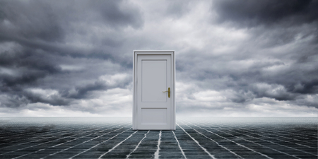 3d rendering of closed white door on endless stone ground in gloomy clouds. Stock Photo