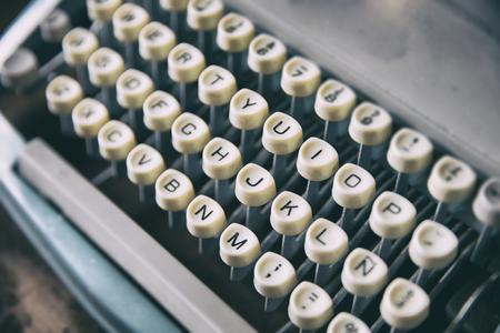 Keyboard placed on retro typewriter. Horizontal indoors shot Stock Photo