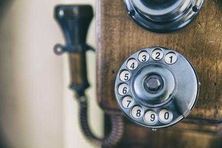 Close-up retro phone dial-plate. Horizontal indoors shot.  Stock Photo