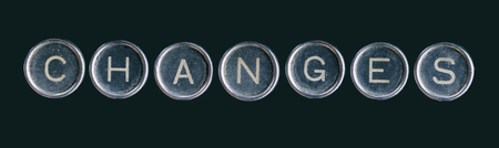 metallic button: The word changes made with the buttons of the typewriter machine isolated on black.