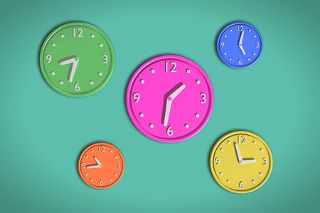 3d rendering of a composition with a lot of colored clocks on green background. Its a JPG image. Stock Photo