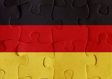 Illustration of a flag of Germany over some puzzle pieces. Its a JPG image. Stock Photo