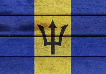 americas: Illustration of Barbados flag over a wooden textured surface Stock Photo