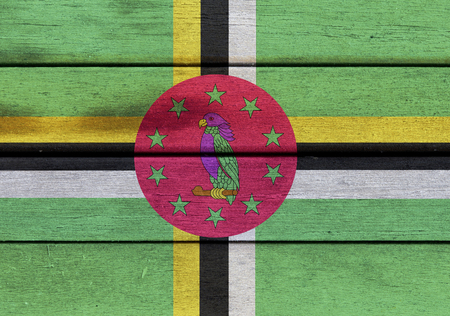 the americas: Illustration of Dominica flag over a wooden textured surface