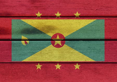americas: Illustration of Grenada flag over a wooden textured surface