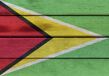 americas: Illustration of Republic of Guyana flag over a wooden textured surface