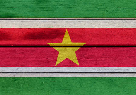 americas: Illustration of Suriname flag over a wooden textured surface Stock Photo