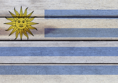 americas: Illustration of Uruguay flag over a wooden textured surface