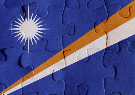 Illustration of a flag of Marshall Islands over some puzzle pieces. Its a JPG image.