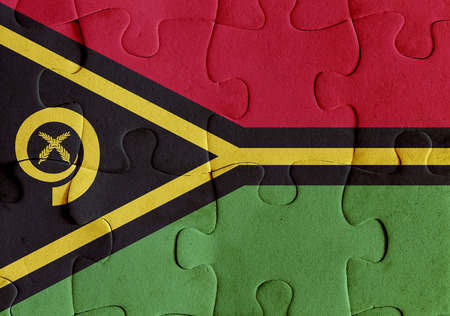 Illustration of a flag of Vanuatu over some puzzle pieces. Its a JPG image.