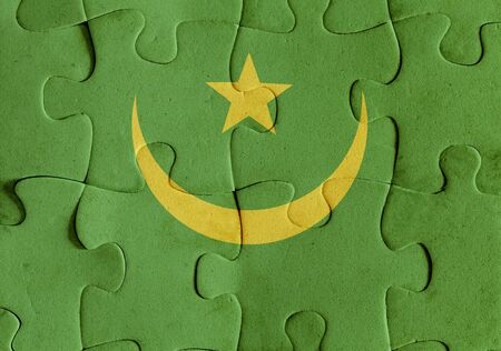 Illustration of a flag of Mauritania over some puzzle pieces. Its a JPG image.