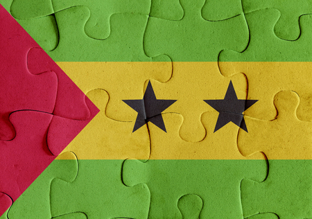 Illustration of a flag of Democratic Republic of Sao Tome and Principe over some puzzle pieces. Its a JPG image. Stock Photo