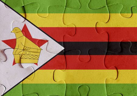 Illustration of a flag of Republic of Zimbabwe over some puzzle pieces. Its a JPG image. Stock Photo