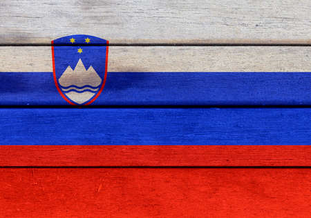 Illustration of Slovenia flag over a wooden textured surface
