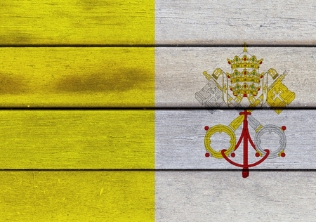 Illustration of Vatican flag over a wooden textured surface