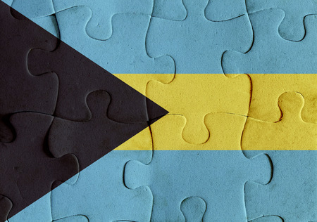 Illustration of a flag of Bahamas over some puzzle pieces. Its a JPG image.