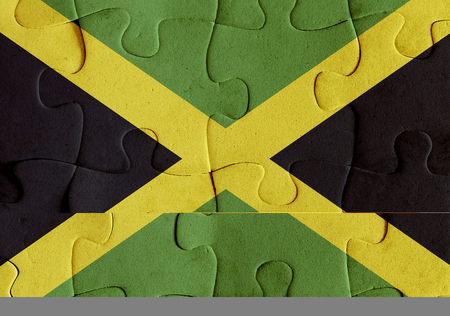 Illustration of a flag of Jamaica over some puzzle pieces. Its a JPG image.