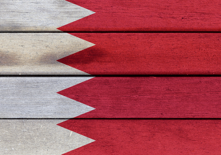Illustration of Kingdom of Bahrain flag over a wood surface