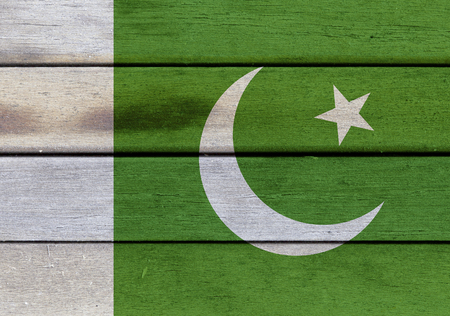 Illustration of Pakistan flag over a wood surface Stock Photo