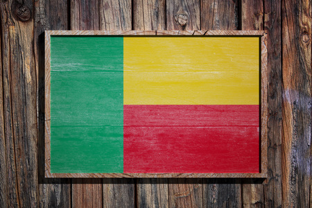 3d rendering of Benin flag on a wooden frame over a planks wall