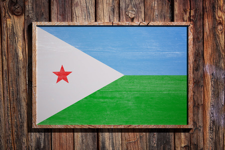 3d rendering of Djibouti flag on a wooden frame over a planks wall