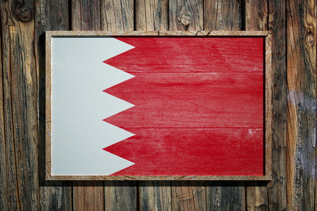 3d rendering of Bahrain flag on a wooden frame over a planks wall