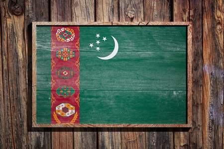 3d rendering of Turkmenistan flag on a wooden frame over a planks wall