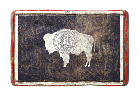 3d rendering of a Wyoming State flag over a rusty metallic plate. Isolated on white background.