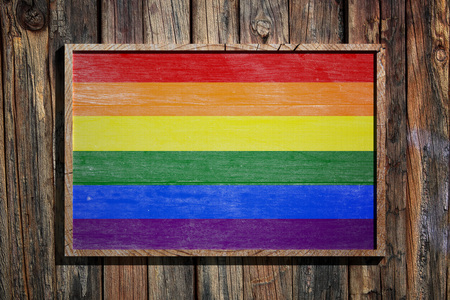 3d rendering of a colorful Gay flag on wooden background