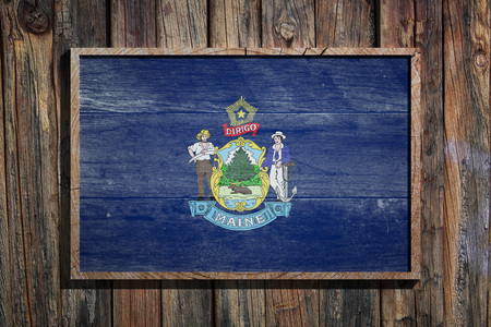3d rendering of a Maine State USA flag on a wooden frame and a wood wall