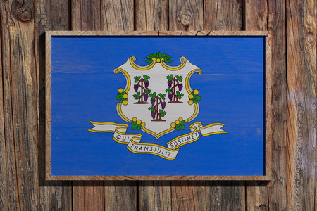 3d rendering of a Connecticut State USA flag on a wooden frame and a wood wall