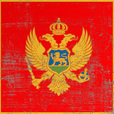 3d rendering of Montenegro flag in a scratched surface Imagens