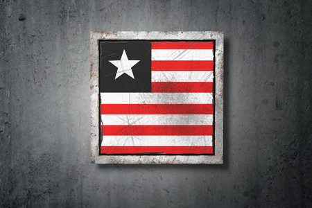 3d rendering of an old Liberia flag in a concrete wall Stock Photo