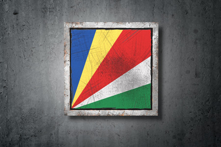 3d rendering of an old Seychelles flag in a concrete wall Фото со стока