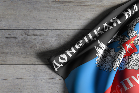 3d rendering of Donetsk Peoples Republic flag over a wooden surface