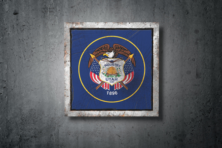 3d rendering of an old Utah American State flag in a concrete wall Stock Photo