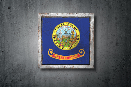 3d rendering of an old Idaho American State flag in a concrete wall Stock Photo