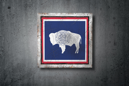 3d rendering of an old Wyoming American State flag in a concrete wall Stock Photo