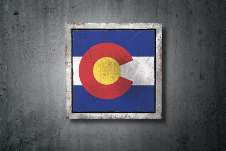 3d rendering of an old Colorado American State flag in a concrete wall