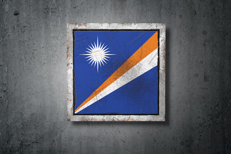 3d rendering of a Marshall Islands flag in a concrete wall 写真素材