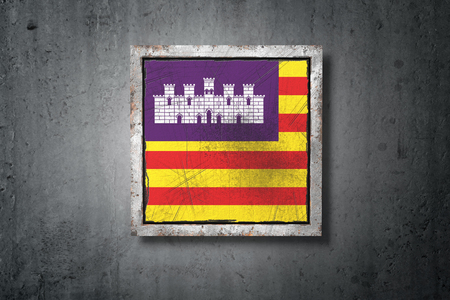 3d rendering of a Balearic islands spanish community flag in a concrete wall