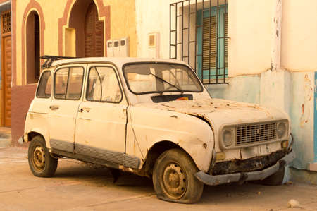 Careless car on a street in Asilah, north of Morocco. Stock Photo