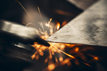 Metal sawing with sparks close up Фото со стока