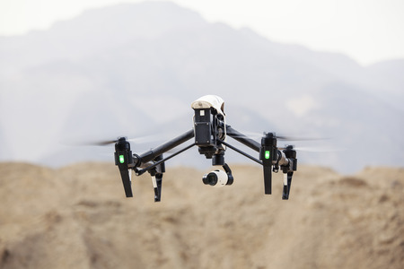 Flying drone, filming video in the mountains