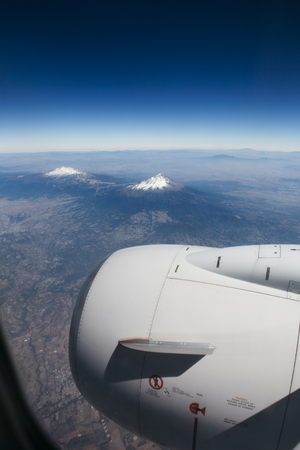 Popocatepetl and Iztaccihuatl Viewed from the airplane arriving to Mexico City, Mexico Фото со стока