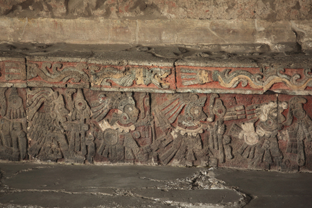 Warriors Relief - Templo Mayor, Mexico CityWith bas relief images carved on stone. The images are painted on a red background.The images depict warriors converging to a ball of straw (hay, in Spanish) called zacatapayoli Containing maguey thorns With Thei