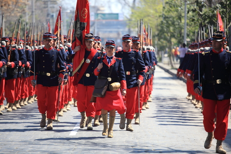 cadet blue: Santiago, Chile - September 19, 2011: Soldiers in uniforms of the battalion 6 of the Pacific War age, which occurred between 1879 and 1883, going to march in the great military parade in commemoration of the independence of Chile.