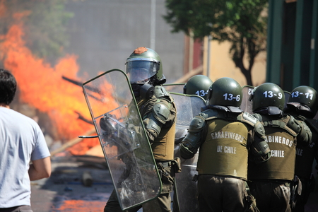 Santiago, Chile - September 22, 2011: Chilean riot disperse protesters during a student strike in Santiagos Downtown, Chile. Protesters demand the government to improve education quality.