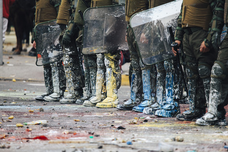 Painted boots of riot police.